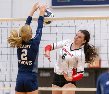 Cary-Grove junior Alexis German (L) blocks the hit by Huntley's Marissa Deem Thursday, August 23, 2018 in Cary. Cary played hard throughout but lost in three sets.  KKoontz – For Shaw Media
