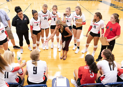 Huntley head coach Karen Naymola talks with her team during a timeout Thursday, August 23, 2018 in Cary.  The Red Raiders take the match over Cary-Grove in three sets. KKoontz – For Shaw Media
