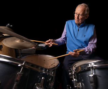 Bob Blazier plays the drums in the basement of his Crystal Lake home Friday, August 24, 2018. He loves to put on headphones and drum along with his favorite Jazz musicians.  KKoontz – For Shaw Media