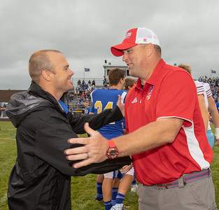 Marion Central Catholic Head coach Mike Maloney (R) and Johnsburg head coach Sam Lesniak (L) shake hands before the game Friday, August 24, 2018 at Johnsburg. Maloney was head coach at Johnsburg for three years before going on to coach at Marion. KKoontz – For Shaw Media