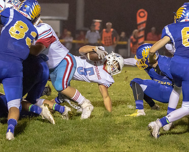 Marion Central Catholic running back, Luke Rogers, looks for a hole against Johnsburg Friday, August 24, 2018 in Johnsburg. Marion Central went on to win the game 14-13. KKoontz – for Shaw Media