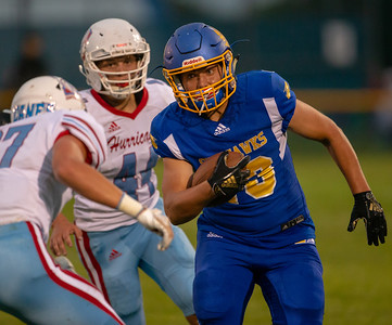 Johnsburg wide receiver Austin Lichtenstein looks for daylight after catching a pass Friday, August 24, 2018 against Marion Central Catholic in Johnsburg. Marion Central went on to win the game 14-13. KKoontz – For Shaw Media