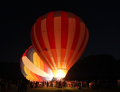 Candace H. Johnson-For Shaw Media The Featherlight II and the PH-One hot air balloons brighten up the night during the 6th Annual Color Aloft Balloon Festival at Central Park in Grayslake.(8/25/18)
