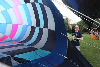 "Candace H. Johnson-For Shaw Media Volunteer Dr. Cheryl Lentz, of Grayslake helps to inflate the ""Traveller,"" hot air balloon during the 6th Annual Color Aloft Balloon Festival at Central Park in Grayslake.The hot air balloon is owned by Kim Neill, of Riverwoods.(8/25/18)"