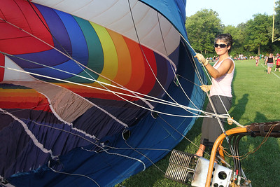 Candace H. Johnson-For Shaw Media Nancy Lemke, of Grayslake helps hold the Featherlight II hot air balloon as it is inflating during the 6th Annual Color Aloft Balloon Festival at Central Park in Grayslake.Lemke and her partner, Skip Goss, took a ride in the hot air balloon with the pilot, Alan Zielinski, of Niles.(8/25/18)