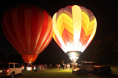 Candace H. Johnson-For Shaw Media The PH-One and Featherlight II hot air balloons light up the night during the 6th Annual Color Aloft Balloon Festival at Central Park in Grayslake.(8/25/18)