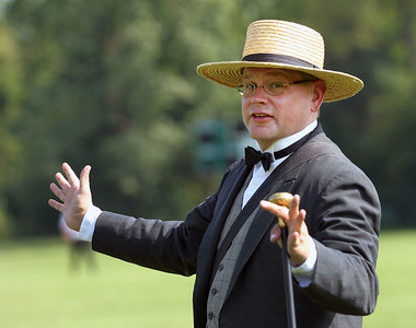 Candace H. Johnson-For Shaw Media Dave Oberg, of Villa Park entertains the crowd as the barrister (umpire) during the 8th Annual Vintage Baseball Match between the Grayslake Athletics and the McHenry County Independants in Central Park in Grayslake. The game was sponsored by the Grayslake Heritage Center & Museum.(8/25/18)