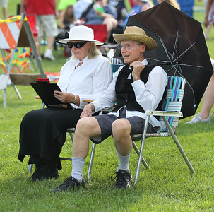 Candace H. Johnson-For Shaw Media Joyce Norton, of Grayslake keeps score as she sits next to her husband, Terry, during the 8th Annual Vintage Baseball Match between the Grayslake Athletics and the McHenry County Independants in Central Park in Grayslake. The Nortons are members of the Grayslake Historical Society and have been married for fifty-three years.(8/25/18)