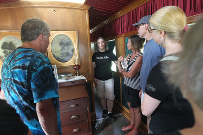 Candace H. Johnson-For Shaw Media Docent Shannon Brown, of Bloomington, Ind., talks to visitors inside the parlor of the 2015 Lincoln Funeral Car on display in downtown Antioch. (8/26/18)