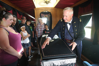 Candace H. Johnson-For Shaw Media Wayne Carle, of Antioch portrays a Lt. Colonel of the1st Brigade Illinois Volunteers as he talks about President Abraham Lincoln's casket inside the 2015 Lincoln Funeral Car on display in downtown Antioch.(8/26/18)