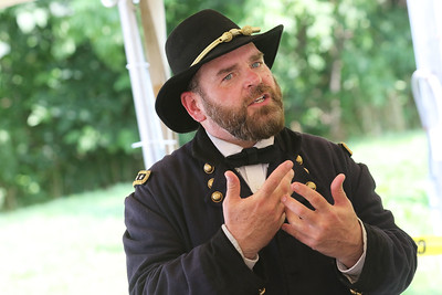 Candace H. Johnson-For Shaw Media Wayne Issleb, of Trevor, Wis., portrays General Ulysses S. Grant, as he answers questions about the Civil War at the 2015 Lincoln Funeral Car on display in downtown Antioch. (8/26/18)