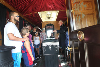 Candace H. Johnson-For Shaw Media Wayne Carle, of Antioch portrays Lt. Colonel of the1st Brigade Illinois Volunteers as he talks about President Abraham Lincoln's casket inside the 2015 Lincoln Funeral Car on display in downtown Antioch.(8/26/18)