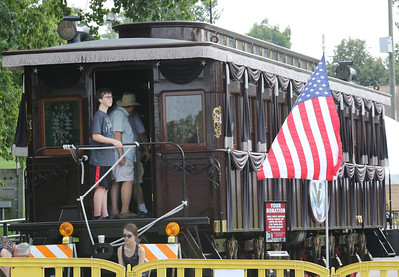 Candace H. Johnson-For Shaw Media Randall Dawson, 13, of Wauconda looks out from the 2015 Lincoln Funeral Car on display in downtown Antioch. (8/26/18)