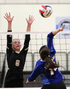 Candace H. Johnson-For Shaw Media Grayslake North's Jessica Pozezinski tries to block a shot by Johnsburg's Sedona Pecucci in the second game at Grayslake North High School in Grayslake. Grayslake North won 24-26, 25-20, 25-18. (8/28/18)