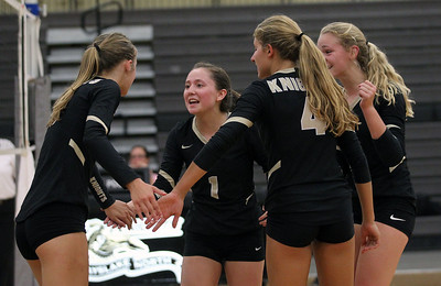 Candace H. Johnson-For Shaw Media Grayslake North's Lindsey Diep (#1) and her teammates celebrate a point against Johnsburg in the second game at Grayslake North High School in Grayslake. Grayslake North won 24-26, 25-20, 25-18. (8/28/18)