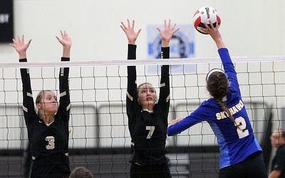 Candace H. Johnson-For Shaw Media Grayslake North's Taylor Ebersohl and Emily Porter look to block an attack by Johnsburg's Sheridan Milewski in the second game at Grayslake North High School in Grayslake. Grayslake North won 24-26, 25-20, 25-18. (8/28/18)