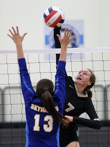 Candace H. Johnson-For Shaw Media Grayslake North's Emily Porter (#7) makes an attack against Johnsburg's Sedona Pecucci in the second game at Grayslake North High School in Grayslake. Grayslake North won 24-26, 25-20, 25-18. (8/28/18)