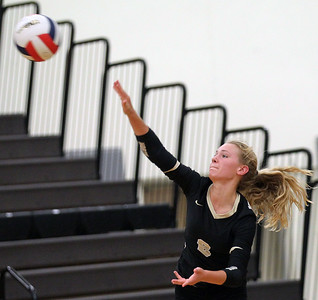 Candace H. Johnson-For Shaw Media Grayslake North's Jessica Pozezinski serves against Johnsburg in the first game at Grayslake North High School in Grayslake. Grayslake North won 24-26, 25-20, 25-18. (8/28/18)