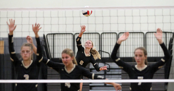 Candace H. Johnson-For Shaw Media Grayslake North's Jessica Pozezinski serves against Johnsburg in the second game at Grayslake North High School in Grayslake. Grayslake North won 24-26, 25-20, 25-18. (8/28/18)