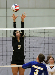 Candace H. Johnson-For Shaw Media Grayslake North's Emmy Bongiovanni reaches for a block to stop an attack by Johnsburg's Adisyn Illg in the first game at Grayslake North High School in Grayslake. Grayslake North won 24-26, 25-20, 25-18.(8/28/18)
