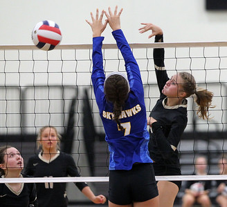 Candace H. Johnson-For Shaw Media Grayslake North's Taylor Ebersohl (on right) gets past the block by Johnsburg's Shannon Flynn in the second game at Grayslake North High School in Grayslake. Grayslake North won 24-26, 25-20, 25-18. (8/28/18)