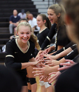 Candace H. Johnson-For Shaw Media Grayslake North's Jessica Pozezinski greets her teammates as she is announced before the start of their game against Johnsburg at Grayslake North High School in Grayslake. Grayslake North won 24-26, 25-20, 25-18. (8/28/18)