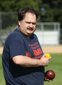 Candace H. Johnson-For Shaw Media Jason Coy, of Wildwood carries some bocce balls to throw on the court during Special Olympics Bocce Ball practice next to the Warren Township Center in Gurnee. (7/30/19)