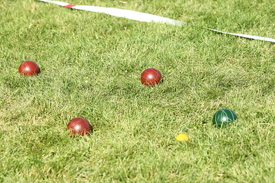 Candace H. Johnson-For Shaw Media Bocce balls are thrown on the court by athletes to get close to the yellow target ball during Special Olympics Bocce Ball practice next to the Warren Township Center in Gurnee. (7/30/19)