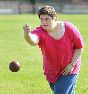 Candace H. Johnson-For Shaw Media Sarah Gouris, 38, of Gurnee throws a bocce ball and aims for the target ball during the first practice of the season of Special Olympics Bocce Ball next to the Warren Township Center in Gurnee. (7/30/19)