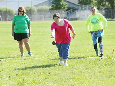 Candace H. Johnson-For Shaw Media Sarah Gouris, 38, (center) throws a bocce ball with Cindy Kaufmann, program assistant, both of Gurnee, and Lauren Massong, 34, of Wadsworth close by during Special Olympics Bocce Ball practice next to the Warren Township Center in Gurnee. (7/30/19)