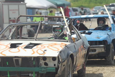Candace H. Johnson-For Shaw Media Rob Gazdzicki, of Beach Park sits in his 1988 Camaro waiting to compete in the Compacts division for the Total Destruction Sunday Demolition Derby during the Lake County Fair at the Lake County Fairgrounds in Grayslake. (7/25-7/28/19)