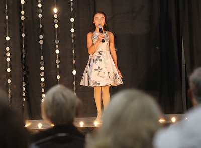 Candace H. Johnson-For Shaw Media Jr. Miss Lake County Fair Queen contestant Darby Leetch, 11, of Round Lake answers a question in the Finalist Competition for the Little & Jr. Miss Lake County Fair Queen Pageant during the Lake County Fair at the Lake County Fairgrounds in Grayslake. Darby went on to win the title of Jr. Miss Lake County Fair Queen 2019.(7/25-7/28/19)