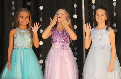 Candace H. Johnson-For Shaw Media Little Miss Lake County Fair Queen Contestants Jayla Wascow, 8, of Vernon Hills, Talula Buchner, 6, of Lake Villa and Vanessa Kurkowski, 7, of Libertyville wave and blow kisses to their families while competing in the Little and Jr. Miss Lake County Fair Queen Pageant during the Lake County Fair at the Lake County Fairgrounds in Grayslake. Jayla Wascow won the title of Little Miss Lake County Fair Queen 2019. (7/25-7/28/19)