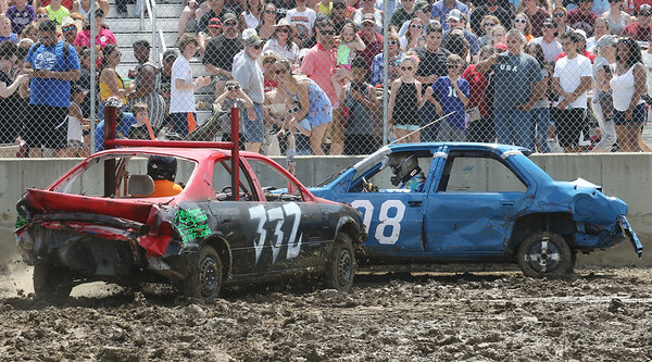 Candace H. Johnson-For Shaw Media Mike Skodaceck, of Elgin rides a 1999 Caprice as he goes after Samm Beelow, of Mundelein in a 1990 Chevy Lumina as they compete in the Compact division at the Total Destruction Sunday Demolition Derby during the Lake County Fair at the Lake County Fairgrounds in Grayslake. Skodacek came in first, Beelow came in second place. (7/25-7/28/19)