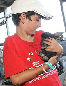 Candace H. Johnson-For Shaw Media Jack Thull, 10, of Grayslake holds a six-week-old Champagne d'Argent rabbit during the Lake County Fair at the Lake County Fairgrounds in Grayslake. The rabbit was owned by Jim Matkovich, of Wadsworth. (7/25-7/28/19)