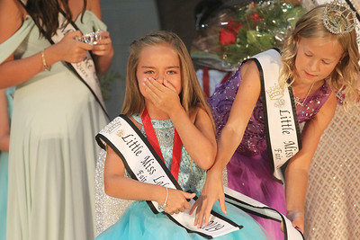 Candace H. Johnson-For Shaw Media Jayla Wascow, 8, of Vernon Hills takes a seat as the new Little Miss Lake County Fair Queen 2019 as the 2018 Little Miss Lake County Fair Queen, Jenna Marasco, 9, of Lake Villa puts on her sash at the Little & Jr. Miss Lake County Fair Queen Pageant during the Lake County Fair at the Lake County Fairgrounds in Grayslake. (7/25-7/28/19)