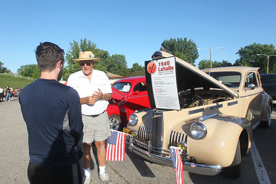 "Candace H. Johnson-For Shaw Media Eli King, of Lake Villa talks with Count Duree ""Ray"" LeClaire, of Spring Grove about his 1940 LaSalle during the 14th Annual Classic & Custom Car Show and ""It's Thursday"" Concert Series featuring the band, Class of '68, at the William E. Brook Entertainment Center in Antioch. (8/3/19)"