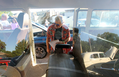 "Candace H. Johnson-For Shaw Media Jim Horsch, of Lindenhurst judges a 1979 Volkswagen Bus during the 14th Annual Classic & Custom Car Show and ""It's Thursday"" Concert Series featuring the band, Class of '68, at the William E. Brook Entertainment Center in Antioch. The bus was owned by Rick Michur, of Antioch. (8/3/19)"