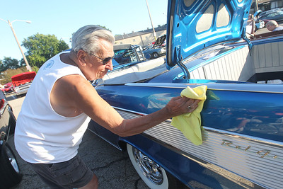 "Candace H. Johnson-For Shaw Media Dave Gates, of Trevor, Wis., wipes down his 1957 Chevrolet Bel Air Convertible he has owned for thirty-five years during the 14th Annual Classic & Custom Car Show and ""It's Thursday"" Concert Series featuring the band, Class of '68, at the William E. Brook Entertainment Center in Antioch. (8/3/19)"
