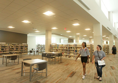 Candace H. Johnson-For Shaw Media Maia Thornton, 20, and Anna Claire Bradbury, 21, both of Lindenhurst walk through the new Lake Villa District Library on opening day at 140 N. Munn Road in Lindenhurst.  (8/5/19)