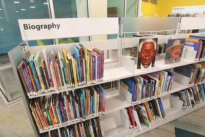 Candace H. Johnson-For Shaw Media Biographical books line up on book shelves in the Youth Services Department on the lower level during opening day of the new Lake Villa District Library at 140 N. Munn Road in Lindenhurst.  (8/5/19)