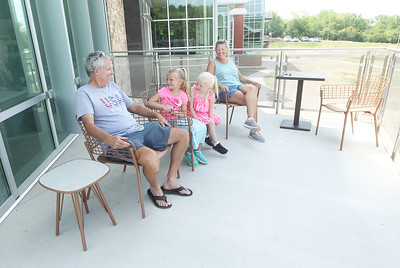 Candace H. Johnson-For Shaw Media Patrick and Cindy Norwick, of Lake Villa and their grandchildren, Kinsley Sebetic, 7, of Pleasant Prairie, Wis., and her sister, Lakyn, 5, sit on the back deck during opening day of the new Lake Villa District Library at 140 N. Munn Road in Lindenhurst.  (8/5/19)