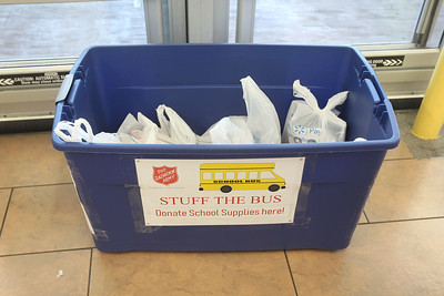 Candace H. Johnson-For Shaw Media Donated school supplies were collected inside the doors of Walmart during the Salvation Army's Stuff The Bus in Gurnee. (8/3/19)