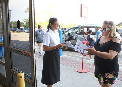 Candace H. Johnson-For Shaw Media Volunteer Hannah Valladares, 16, of Waukegan talks with Erin Dempsey, of Lindenhurst about the school supplies she can buy and donate during the Salvation Army's Stuff the Bus at Walmart in Gurnee. The school supplies will be donated to Waukegan schools. (8/3/19)