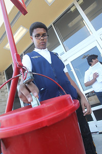 Candace H. Johnson-For Shaw Media Joshua Buckley, 17, of Waukegan made a cash donation during the Salvation Army's Stuff the Bus at Walmart in Gurnee. Buckley is a Walmart associate who was on his break for lunch. (8/3/19)