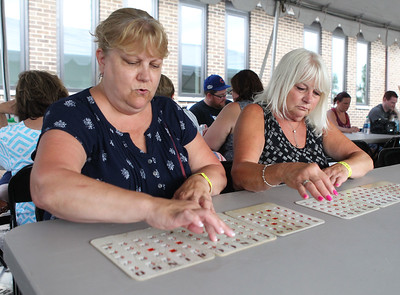 Candace H. Johnson-For Shaw Media Sue Kelly, of Lindenhurst and her sister, Linda Larsen, of Antioch play Bingo during Lindenfest at the Village Hall Center in Lindenhurst. (8/10/19)