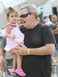 Candace H. Johnson-For Shaw Media Jade Blackowicz, sixteen-months-old, of Lindenhurst dances with her grandfather, Tom, to the music of a band called, Gone Country, during Lindenfest at the Village Hall Center in Lindenhurst. (8/10/19)