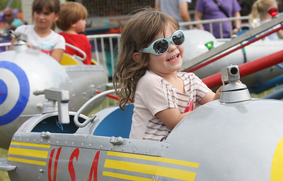 Candace H. Johnson-For Shaw Media Natalie Reynolds, 4, of Lindenhurst enjoys a ride during Lindenfest at the Village Hall Center in Lindenhurst. (8/10/19)