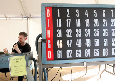 Candace H. Johnson-For Shaw Media Jonny Yarnall, of Lindenhurst calls out the numbers for Teen Bingo during Lindenfest at the Village Hall Center in Lindenhurst. (8/10/19)
