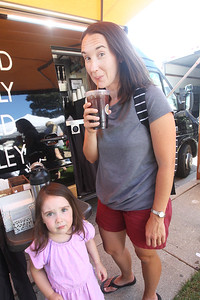 Candace H. Johnson-For Shaw Media Amanda Stapleton, of Grayslake stands next to her daughter, Joy, 3, as she takes a sip of her iced coffee ordered from the Swirl Café coffee & bakery food truck at the Libertyville Farmers Market.